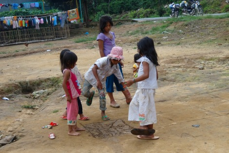 Playing hopscotch with the kids in the village
