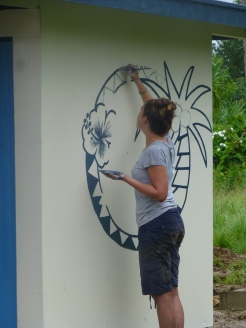 Getting the logo painted on the side of our toilets