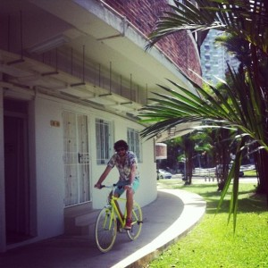 Sam cycling around his new hipster home