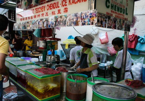 Lady making cendol in a market in Malaysia