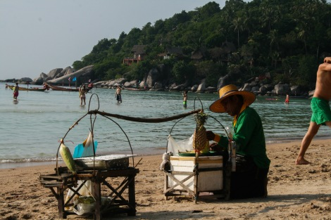 Man selling sweetcorn on the beach, Koh Tao, Thailand.